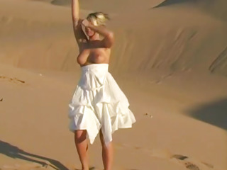 Bendy busty teen babe shows off na‹ve assets first of all sand dunes