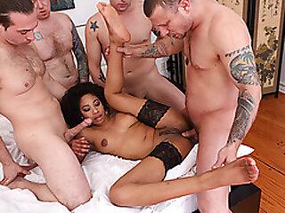Ebony babe gangbanged away from 4 white dicks